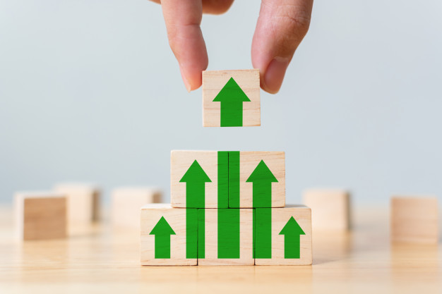 ladder-career-path-business-growth-success-process-wood-block-stacking-as-step-stair-with-arrow-up-hand-putting-wooden-cube-block-top-pyramid_20693-232.jpg