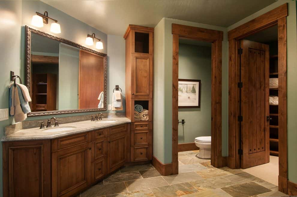 salt-lake-city-rustic-bathroom-designs-with-black-towel-rings-and-storage-dark-wood-trim-min.jpg